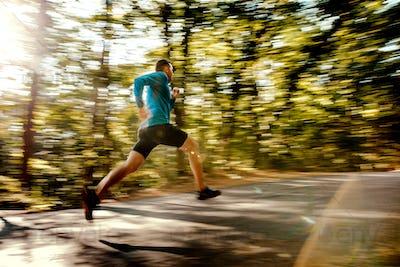 blurred motion male runner