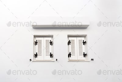 Windows with closed shutters