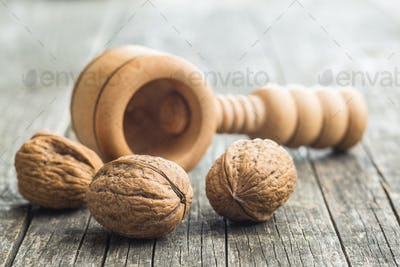 Dried walnuts and nutcracker.