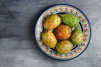 Opuntia ficus-indica, Barbary fig, cactus pear, prickly pear, Indian fig opuntia on a plate