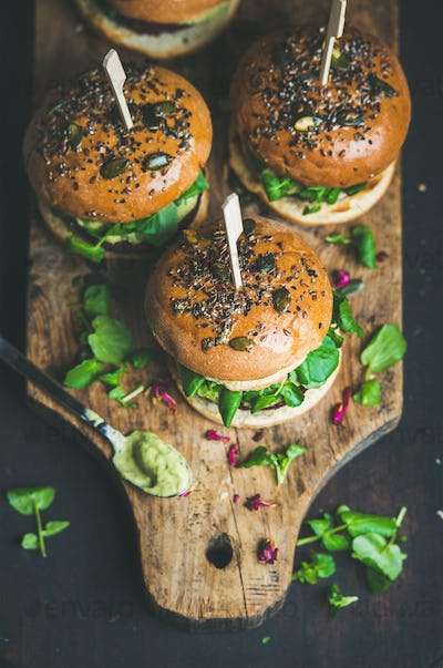Healthy homemade vegan burger with beetroot-quinoa patty on wooden board