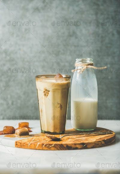Iced caramel latte coffee cocktail and milk in bottle