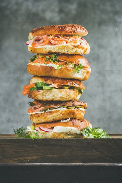 Close-up of Bagels heap with salmon, eggs, vegetables and cream-cheese