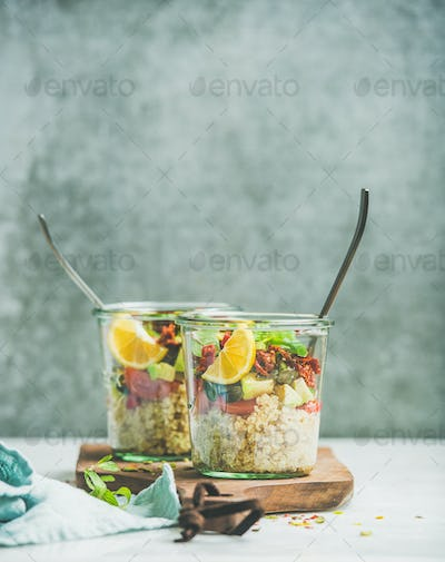 Healthy vegetarian salad with quionoa, avocado, dried tomatoes