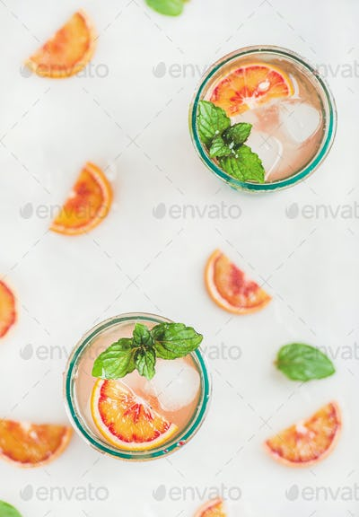 Blood orange fresh summer lemonade in glasses, top view