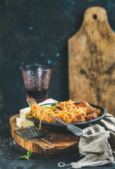 Spaghetti with meatballas, basil, parmesan cheese and red wine