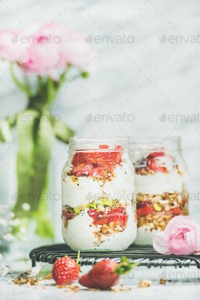 Greek yogurt, granola, strawberry breakfast jars, pink raninkulus flowers