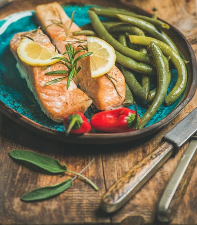 Roasted salmon with lemon, rosemary, chilli pepper and beans