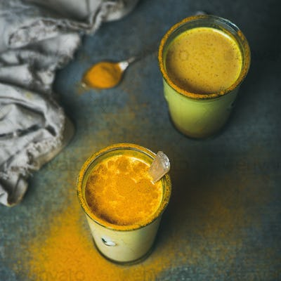 Golden milk with turmeric powder, dieting and weight loss concept