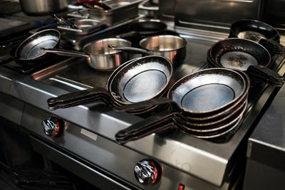 Metal black pans on restaurant kitchen