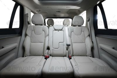 back seats of modern luxury car, white perforated leather interior