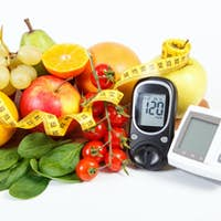 Glucometer for checking sugar level, blood pressure monitor, fruits with vegetables and centimeter