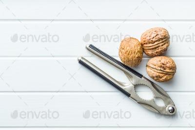 Tasty dried walnuts and nutcracker