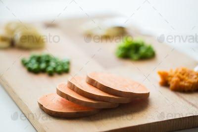 sliced pumpkin on wooden board