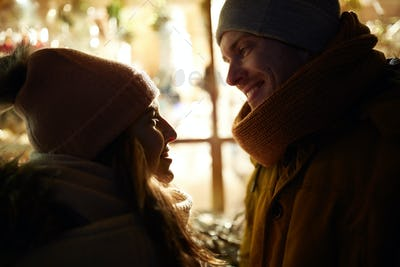 close up of happy couple in winter closes