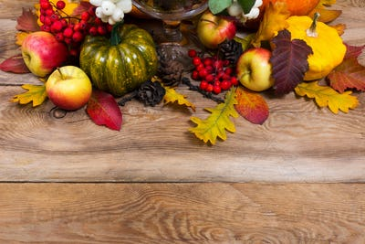 Fall background with green pumpkin, yellow squash, oak leaves, c