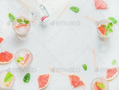 Cold refreshing alcohol cocktail with fresh grapefruit, copy space