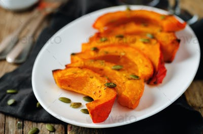 Rosemary honey roasted pumpkin wedges with pumpkin seeds