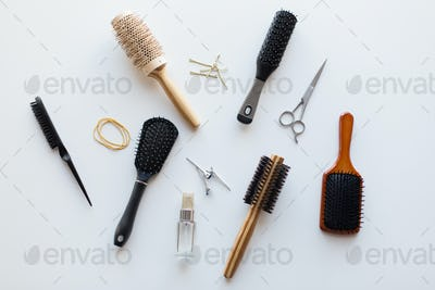 scissors, hair brushes, clips and styling spray