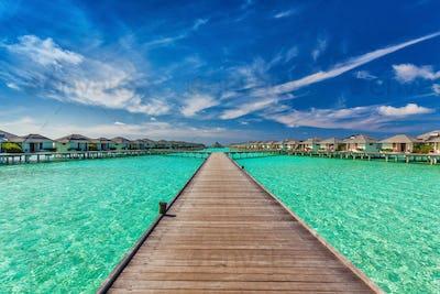 Beautiful water villas on the sea with the bridge, Maldives