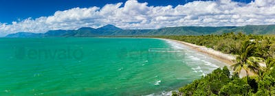 Port Douglas four mile beach and ocean on sunny day, Australia