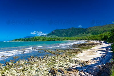 Ellis Beach with rocks near Palm Cove, Queensland, Australia