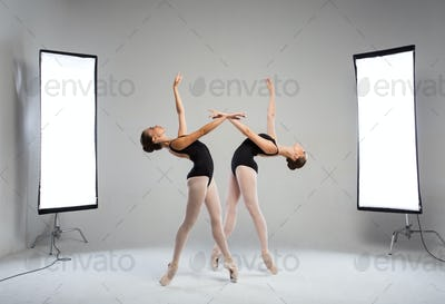 Backstage shooting two graceful dancers in the studio