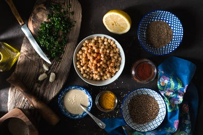 Ingredients for cooking falafel, chickpeas, tahini and spices