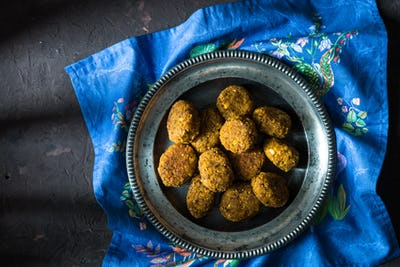 Vegetarian falafel on a tin plate on a blue napkin top view