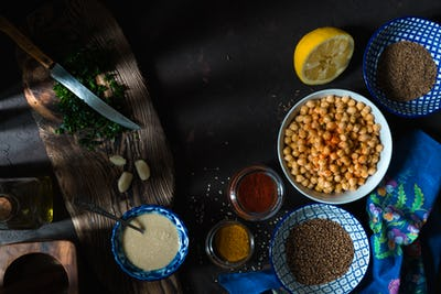 Ingredients for cooking falafel, chickpeas, tahini and spices closeup