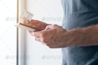 Man registering new GMS sim card on mobile phone