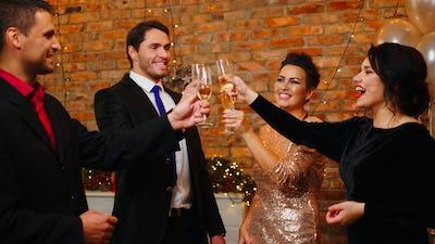 Happy beautiful couples celebrating Christmas