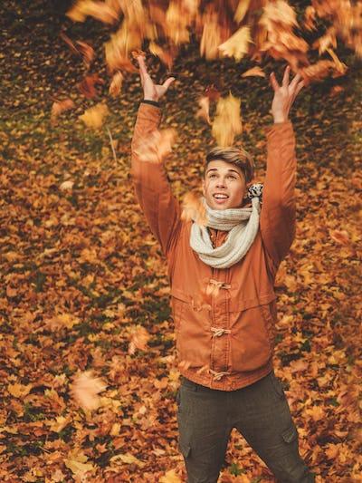 Happy man in autumn park