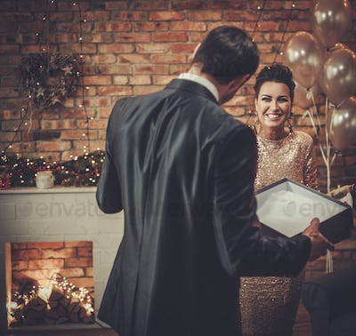 Couple with a gift on Christmas eve