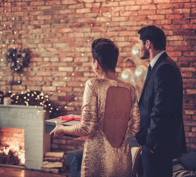 Beautiful couple with a Christmas gift box