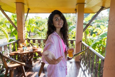 Woman On Summer Terrace Hold Hand Drink Orange Juice, Happy Smiling Girl In Morning Welcoming