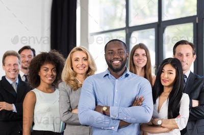 African American Businessman Boss With Group Of Business People In Creative Office, Successful Mix