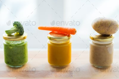 vegetable puree or baby food in glass jars