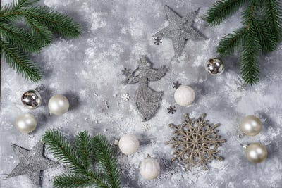 Christmas still life. Silver toys and decorative Christmas ornaments