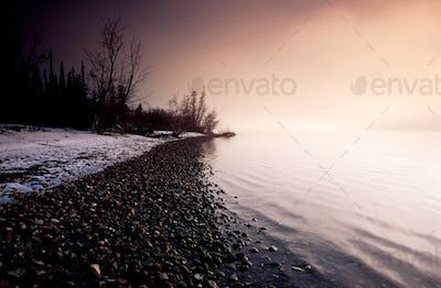 Winter landscape scene Tagish Lake lakeshore Yukon