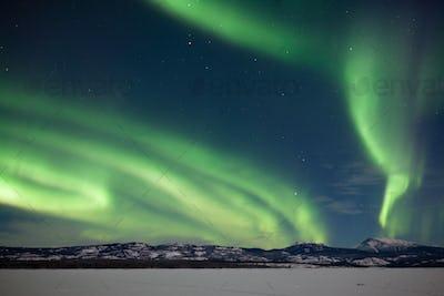 Aurora borealis Northern Lights snowy winter scene