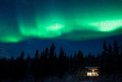 Taiga home under Northern Lights Aurora borealis