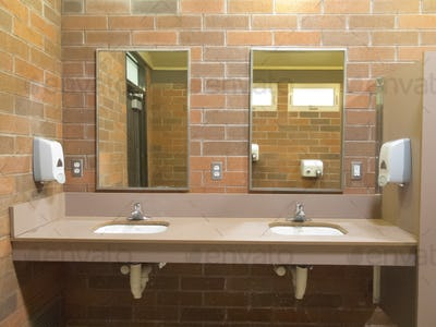 Simple clean public washroom sinks mirrors