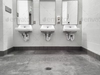 Clean simple public washroom sinks mirrors