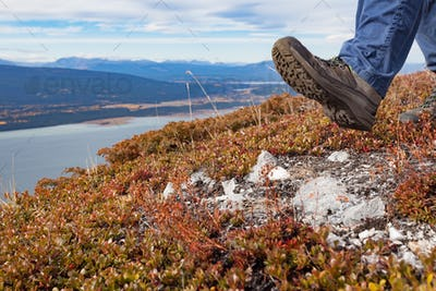 Hiker hiking above Little Atlin Lake Yukon Canada