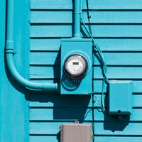 Smart grid electric meter connection on blue wall
