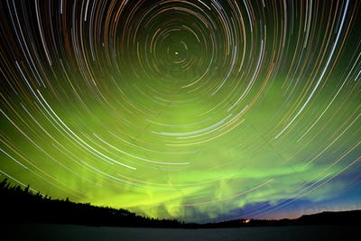Star trails and Northern lights in night sky