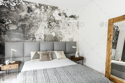Bedroom with abstract grunge wall