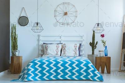 Ethnic bedroom, copper clock, lamps