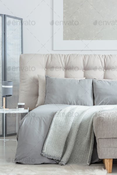 Beige bed with pillows